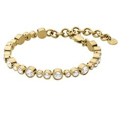 Teresia Tennis Bracelet by DYRBERG/KERN. Linked tennis bracelet in gold plated stainless steel embellished with Swarovski® crystals. Presented with signature gift packaging.