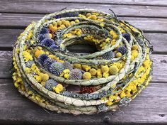 This wreath has a styrofoam base and is decorated with dried grass, braided reed mace,craspedia, dried plants , globe - thistle. External diameter- 40cm (15,0) Internal diameter- 13 cm (5.1) Thickness- 6 cm (2.3) This wreath is something different and special, it can add a little exclusiveness to your home or be a very special gift. Feel free to contact me if you have any kind of questions. Have a lovely day