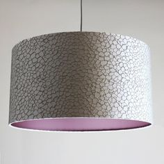 Bespoke 60cm Drum Shade Kingley Oyster With Royalty Dusk Lining This bespoke 60cm drum shade with the beautiful Ashley Wilde Kingley Oyster design, is lined with a complementing Satin Sheen Dusk lining. The shade would truly make a real statement in any home.