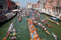 venice regatta = Rowers take part in the Vogalonga, or Long Row on the Grand Canal and the Venice lagoon