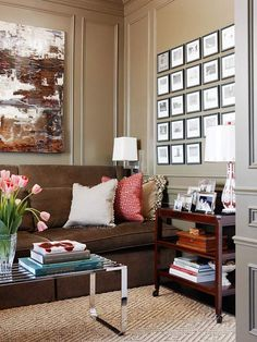 Splashes of color and white lighting keep this space feeling fresh. More living room design ideas:  http://www.bhg.com/rooms/living-room/makeovers/living-room-decorating-ideas/?socsrc=bhgpin091313artshow&page=23