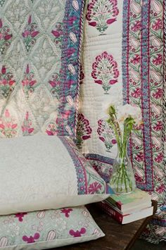 RUBY TULIPS & CARNATIONS The 'Pamira' bed story is a tribute to the resplendent valley tucked between the snow-capped Pamira mountains. A classic yet contemporary handblock print of stylized wild tulips and carnations inspired by the patterns of Iznik ceramics. The bed story includes fine Jaipuri 'razais' (quilts), soft muslin 'dohar' and cotton shams Shop the #Pamira bed story on our #WebBoutique . #SustainableLuxury #SilkRoute #Fergana #Pehchaan #InBloom #HandBlock Textile Patterns, Textile Prints, Bed Story, Summer Quilts, Bohemian Bedding, Earth Design, Diwali Decorations, Indian Fabric, China Painting