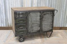 This industrial storage unit comes from our huge range of unusual vintage and industrial restaurant furniture. This would make a great waiter station...
