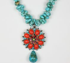 Tuscon Necklace - 16 inch chunky turquoise rocks with coral medallion, $98. Buy it now at www.faithco.net.