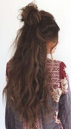 Embrace your messy hair!!! Add a braid and a half up top knot for a cool and trendy hairstyle!!