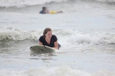 Lady surfing in Guiones Nosara, Costa Rica