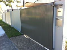 Automatic sliding gate in powder coated aluminium with vertical slats