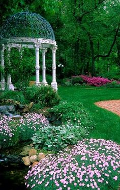 If I had a huge garden, I'd make room for this gazebo.  Sort of like out of Thomas Kincaid's paintings.