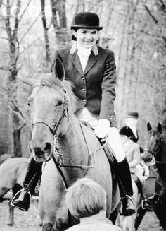 """Jackie Onassis rides her horse a """"Bit of Irish"""" during a Thanksgiving fox hunt in New Jersey. 