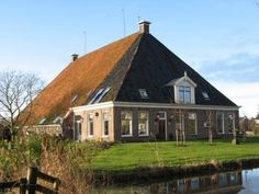 Friesland - typical barn  attached farmhouse. Beautiful buildings.
