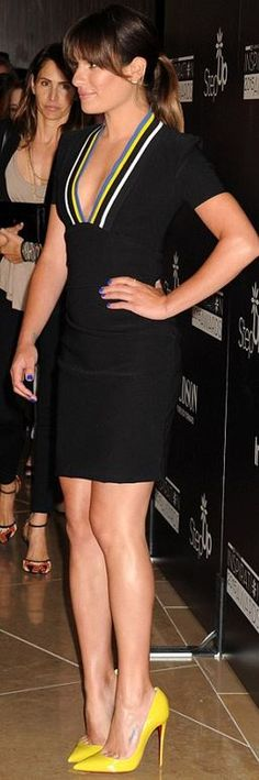 Who made  Lea Michele's black stripe dress and yellow pumps?