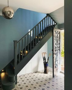 Geometric Tiles, umbrella stand and dark staircase! Geometric Tiles, umbrella stand and dark staircase! Narrow Staircase, Narrow Entryway, Staircase Design, Floating Staircase, Painted Staircases, Painted Stairs, Hallway Colours, Mandarin Stone, Flur Design