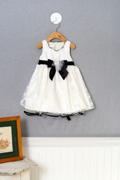 A Bonnie Baby dress with black bow and trim accents, 18M $27.99