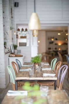 Colorblocked wooden chairs around dining table. Genius.