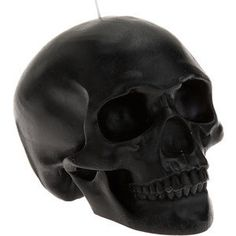 The Black Skull Candle is simply stunning. It weighs over a pound and is about 5 in. tall.  It is very detailed.