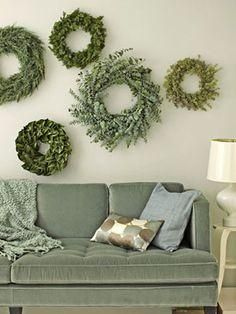 Style idea for holiday decor: Deck the halls with indoor wreaths of many sizes and greenery types (eucalyptus wreath, boxwood wreath, olive wreath, magnolia wreath), and style them in a gallery wall in your living room! A nontraditional Christmas decoration idea that still feels festive and seasonal!