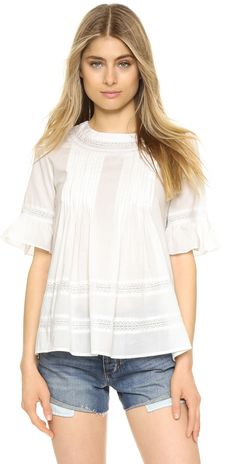 572be3e2f5 ENGLISH FACTORY Lace Boho Blouse accented with knife pleats and lace. The  half sleeves are trimmed with ruffles