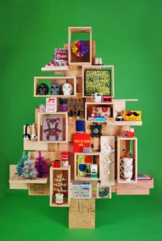 A wooden Christmas tree with different items to decorate it. What a lovely piece!