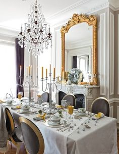 parisian-style dining room with french blue wall color. the marble