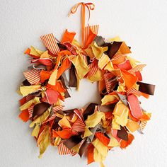 Fabric Scraps Wreath: Make this messy-chic wreath with some left-over fabric scraps in fun fall colors. Work an old wire hanger into a circle and tie the scraps around until the wreath is covered - the messier the better!