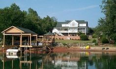 lake house with boat dock