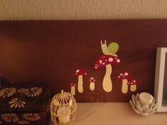 Snail on toadstool.