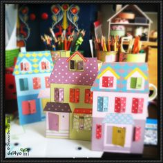 This papercraft is a little village Advent Calendar, designed by goscoutcreative. You can download this calendar paper craft here: Little Village Advent Calendar Free Papercraft Download Source: