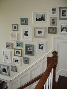 I like the gallery wall above the wainscotting on the stairs.  I like the different colors of franmes all together.