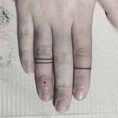 lindsay phylo // Black lines + dot on fingers. #blacklines #linetattoos #fingertattoo #minimalisttattoo #tribaltattoo #linework