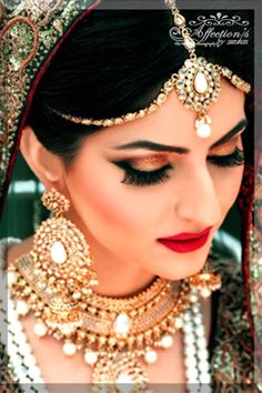 antique gold eye makeup , gold and bronze eye makeup , deep red lips , ruby woo lips , natural blush , beautiful bridal makeup