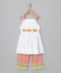 This bright set has patterns that would send artists into a tizzy. Its button-up back, embroidered smocking and elastic waistband are the secret brushstrokes of success for this airy ensemble.