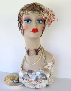 .This is Fanny Flapper - a shell encrusted mannequin head wearing two vintage pearly necklaces and a handmade shell headpiece.❤❤❤