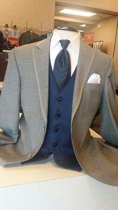 The Groom! Gray tuxedo, navy vest, navy bow tie (instead). Men's Warehouse