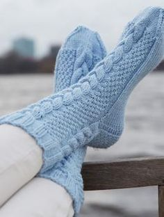 """Ladies' socks, R0211 - Free Pattern: Rustic cables work well with the pale tone of Schachenmayr Regia 6-ply """"Winter Sorbet"""". Satisfy your sock craving with this distinctive pair!"""