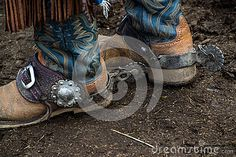 Western cowboy boots and silver spurs for riding horses