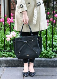 A fabulous refined black leather tote from Coach that is great for a day out shopping. The Turnlock Tie detail is just lovely.