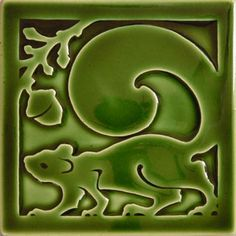 Green Arts and Crafts tile with squirrel and acorn