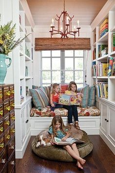 .Reading nook bookcase bookshelves on adjacent walls to the window kids playroom idea book storage toy storage