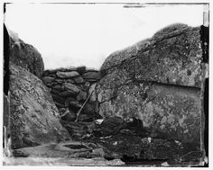 Civil War Photos - 98. Dead Confederate Sharpshooter in the Devil's Den - Gettysburg, PA, July 1863