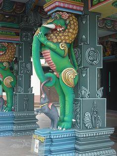A colorful statue of an elephant built into a Hindu temple, Penang, Pulau Pinang, Malaysia.