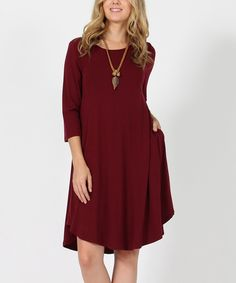 Take a look at this Dark Burgundy Three-Quarter Sleeve Tunic Dress today!