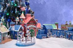 This papercraft is a North Pole Train Station Diorama, designed by Fun Decorations 4 Christmas. The diorama includes Elves Workshop, Polar Bear Ice Rink, P Diy Christmas Paper Decorations, Diy Christmas Village, Paper Christmas Ornaments, Christmas Train, Christmas Villages, 1st Christmas, Holiday Crafts, Christmas Houses, Christmas Ideas