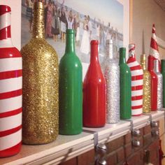 Using wine bottles to decorate and use on a fireplace or even shelves sounds amazing! Even though these are Christmas colors, I could use blues and silvers and gold for a future home/apartment/condo. #DIYHomeDecorWineBottles