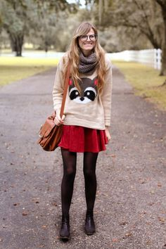 Raccoon sweater with skirt and tights.