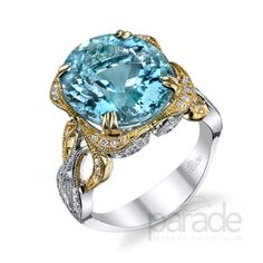 Scrolling 18K yellow and white gold set with 0.39 carats of dazzling diamonds showcase a 7.60 carat sky-blue aquamarine.