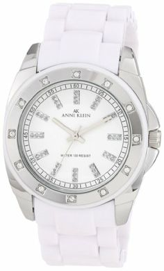 12 clear Swarovski crystals are set in the bezel Silver-tone case with white plastic around the bezel White dial with 12 glitter markers Bla...