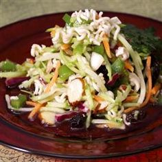 Easy Broccoli Slaw Salad Allrecipes.com    I used cashews and they were yummy too.  No raisins, green onions or bell pepper and it was wonderful!  So... It's safe to omit those if your not a fan and it will still turn out terrific!!  The ramen noodles may sound strange but just go with it.  :)
