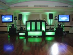 Light Up Stage and DJ Booth With Two Plasma Screens. AmazinGear.com likes this DJ Setup...