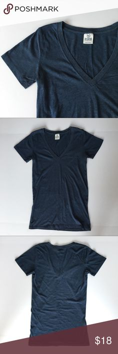 PINK Victoria Secret Blue V-Neck Tee Short sleeve PINK v-neck shirt. Dark blue and super comfy. Has minor pilling as seen in pics, but otherwise great condition; no holes, stains, or snags. Comes from a smoke-free environment :) PINK Victoria's Secret Tops Tees - Short Sleeve