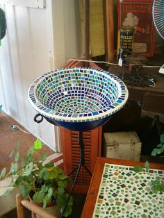 The blue mosaic tile birdbath I donated to my sister's school auction. Made from a reclaimed sink, art glass, and iron hand-forged from an 1803 forge. I LOVE creating!